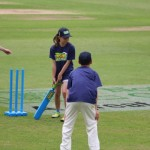 Also on the outfield, a number of local youngsters show us their cricket skills.