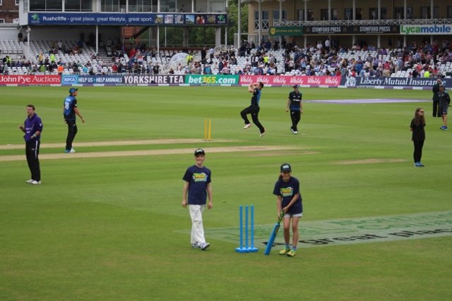 ......show that cricket is a game for all ages, as the New Zealand team warm up behind